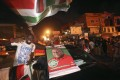 NDC supporters celebrate on Accra streets. Photo: Reuters