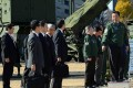 Japanese Prime Minister Yoshihiko Noda (far right) inspects a missile unit in Tokyo on Friday, ahead of North Korea's rocket launch window. Photo: Xinhua