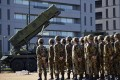 Japan had said it had been preparing missile units to intercept North Korea's rocket. Above, troops in Tokyo. Photo: EPA