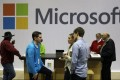 Microsoft employees and guests mingle at a pop-up Microsoft Store. The software giant has angered trade groups and advertisers because it says it will not change an automatic setting in its newest version of Internet Explorer that tells websites not to track user behaviour. Photo: AP