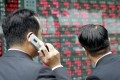 Japanese stocks rose more than one per cent on Thursday morning, buoyed by news that the US Federal Reserve was pushing ahead with fresh monetary easing. Asian stocks generally rose. Photo: AFP