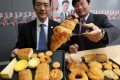 The Food Safety Centre's Samuel Yeung and the Consumer Council's Ron Hui with some of the worst-offending pastries. Photo: Nora Tam