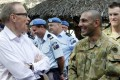 Australian Foreign Minister Bob Carr talks to Australian officers during a visit to their headquarters in Dili on Friday. Photo: EPA