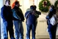 People embrace as they arrive for a prayer vigil at the Newtown United Methodist Church following a shooting at the Sandy Hook Elementary School earlier in the day that left at least 27 people dead, many of them young children, in Newtown, Connecticut, USA, 14 December 2012. Photo: EPA