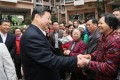 Xi Jinping talks with residents at a community in Shenzhen. Photo: Xinhua