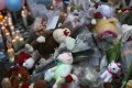 Teddy bears, flowers and candles at one of many makeshift memorials in Newtown. Photo: AFP