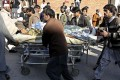 A critically injured polio worker is rushed to hospital following an attack by gunmen in the Pakistani city of Peshawar. Photo: AFP