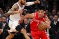 Point Guard Jeremy Lin takes on New York Knicks' centre Tyson Chandler in the first quarter of the game. Photo: Reuters