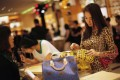 A woman shops in a Louis Vuitton store in Shanghai. Picture: SCMP Photos