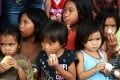 Children eating boiled eggs at an evacuation centre in Poblacion, in the southern Philippines, this month. Photo: EPA
