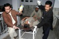 An injured man is wheeled to a hospital after a suicide bombing ripped through a political rally in northwest Pakistan's Peshawar, killing at least nine, including one political leader. Dozens have been injured. Photo: Xinhua