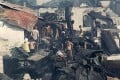 Residents return to their charred homes after fire razed some 500 houses in Manila. Photo: Reuters