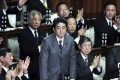 Lawmakers applaud Japan's new prime minister. Photo: Bloomberg