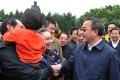 Guangdong's new party chief Hu Chunhua meets with locals at Shenzhen's Lotus Hill during his first official visit to the province. Photo: SCMP