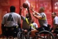 US soldiers, most suffering from amputations, burns and limb loss in Afghanistan play wheelchair basketball. Photo: AFP