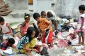 East Timorese children collect recycle items in Dili on Monday. The UN winds up its peacekeeping mission on Monday after 13 years East Timor. Photo: AFP