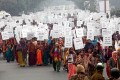 Hundreds of Indian women and men participate in peace march with placards carrying pro-women slogans in New Delhi. Photo: EPA