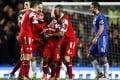 Shaun Wright-Phillips is mobbed by his teammates after scoring against Chelsea. Photo: Xinhua
