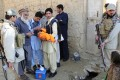 Pakistani security officials escort the heath workers as they administer Polio vaccination to children in Bajaur tribal region near the Afghan border on Wednesday. Photo: EPA
