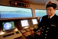 Tony Yeung Pui-keung, manager of the Maritime Services Training Institute, at the helm in the bridge simulator. Photo: Steve Cray