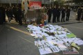 Protest banners and flowers are laid outside the Southern Weekly office in Guangzhou. Photo: AP