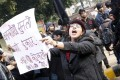 An Indian protester holds a placard and shouts slogans demanding the justice for the late gang rape victim. Photo: EPA