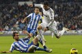 Cristiano Ronaldo (right) goes up against Real Sociedad's Mikel Gonzalez (left) and Daniel Estrada on Sunday. Photo: AP
