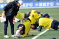 Hong Kong coach Kim Pan-gon puts his players - at least those that turned up - through their paces at Football Club. Photo: Xinhua