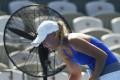 Caroline Wozniacki cools off during a match. Photo: Reuters