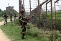 Indian Border Security Force (BSF) soldiers stand guard along fencing near the India-Pakistan Chachwal border outpost, some 65 kms north from the north-eastern Indian city of Jammu. Photo: AFP