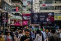 Pedestrians in Causeway Bay, a key retail hot spot in the city. A new survey of small and medium-sized enterprises found that the retail sector expected a shopping bonanza over the Lunar New Year period. Photo: AFP