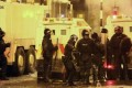Northern Ireland riot police officers confront Pro-British Loyalists who were launching fireworks, petrol bombs and rocks at Newtownabbey in Northern Ireland. Photo AFP