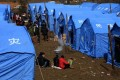 Residents gather at emergency tents in Gaopo village. Photo: AFP