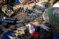 Kachin rebels display the ammunitions they seized from Myanmar soldiers in Laiza, northern Myanmar, last month. Photo: AP