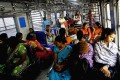 Passengers travel in the women's compartment of a train in Mumbai on Thursday, as a gang-rape case has fuelled anger across India over the treatment of women. Photo: AP
