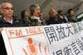 Activists gather outside Eastern Court yesterday. Photo: May Tse