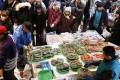 A merchant displays seafood for shoppers at Ameya-yokocho Street in Tokyo. Photo: EPA