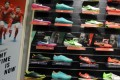 Nike shoes displayed at a shop in Jakarta. The US sporting goods giant is investigating claims its manufacturers in Indonesia are not paying workers properly. Photo: AFP