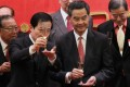 Chief Executive Leung Chun-ying and Yang Jianping (left), deputy director of Beijing's liaison office, offer a toast at a spring reception hosted in the city yesterday. Leung faces a tough day today, when he is scheduled to deliver his maiden policy address. Photo: Edward Wong