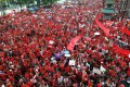 Anti-government red-shirt protesters gather in the streets in September 2010. Photo: EPA