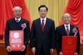 Wang Xiaomo (left) and Zheng Zhemin (right) with President Hu Jintao after receiving their top science awards. Photo: Xinhua