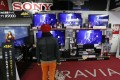 A shopper checks out Sony products at a Tokyo outlet. The company has been mauled by tough competition from South Korean competitors, particularly Samsung Electronics, and is selling assets to raise cash. Photo: Reuters