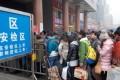 Passengers line to enter the Zhengzhou Railway Station in Zhengzhou ,Henan Province. Photo: Xinhua