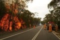 Fire crews at a bushfire burning at West Head Road in Towlers Bay, Australia, on January, 19, 2013. Firefighters in NSW say they've scaled down operations, but it's too early to declare the bushfire crisis over yet. Photo: EPA