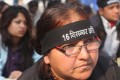 Indian activists wear black head bands in a protest against the gang-rape of a student in New Delhi. Photo: EPA
