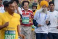Sikh marathon runner Fauja Singh, 101, shows he is still going strong in the Mumbai Marathon on Sunday. Photo: AFP