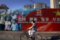 A propaganda poster in central Beijing promotes virtue and patriotism. Photo: Reuters