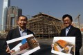 Louis Yu Kwok-lit of the West Kowloon Cultural District Authority and architect Wiliam Lim Ooi-lee in front of the Bamboo Theatre at West Kowloon Cultural District. Photo: Edward Wong