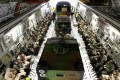 French soldiers aboard a US air force transport plane heading for Mali from Istres airbase, near Marseille, southern France. Photo: AP