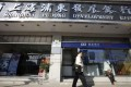 A former deputy head of a Shanghai Pudong Development Bank branch in Zhengzhou allegedly used 6.4 billion yuan in depositors' money to fund loan-sharking schemes. Photo: Bloomberg